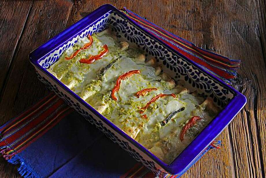 Tortilla Crepe Enchiladas With Rajas, Zucchini & Spinach. Recipe from Jacqueline Higuera McMahan for a column on rajas. Photo: Robert McMahan