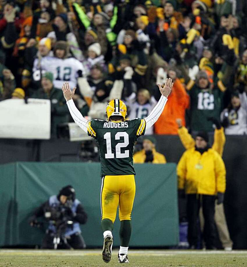 Green Bay Packers quarterback Aaron Rodgers celebrates an 8-yard touchdown run by John Kuhn during the first half of an NFL football game against the New York Giants on Sunday, Dec. 26, 2010, in Green Bay, Wis. Photo: Jeffrey Phelps, AP