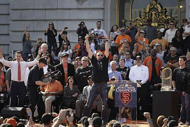 San Francisco Giants' Aubrey Huff (center) waves a red thong in the air during the ceremony in front of City Hall after the World Series parade celebrating the San Francisco Giants win in the 2010 World Series on Monday November 3, 2010 in San Francisco, Calif. Photo: Lea Suzuki, San Francisco Chronicle