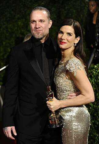 "FILE - Sandra Bullock and Jesse James arrive at the Vanity Fair Oscar party on in this March 7, 2010 file photo taken in West Hollywood, Calif. Sandra Bullock has canceled her appearance at the London premiere of ""The Blind Side"" scheduled for Tuesday March 23, 2010 almost two weeks after winning a Best Actress Academy Award. In a statement released by Warner Bros UK., the 45-year-old actress says she can't attend the event for ""unforeseen personal reasons."" Photo: Peter Kramer, AP"