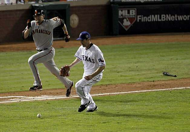 San Francisco Giants first baseman Aubrey Huff (17) tries to beat Cliff Lee on a sacrifice bunt to advance Cody ross and Juan Uribe during game 5 of the 2010 World Series between the San Francisco Giants and the Texas Rangers on Monday, Nov. 1, 2010 in Arlington, Tx. Photo: Carlos Avila Gonzalez, San Francisco Chronicle