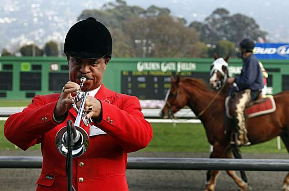"David Hardiman plays the bugle every Saturday and Sunday at Golden Gate Fields. Nine times each day, before each race, Hardiman walks onto the winners circle wearing his uniform, a red huntsman's jacket, knee-high black boots and top hat -- and plays ""First Call"" on his bugle. ""Ta-rah-ta-TAH-ta-rah-ta-rah-ta-ta-ta-ta-tum!"" But what most visitors to the race track donÕt know is Hardiman is the former head of San Francisco State's jazz department and works several gigs per week as a jazz trumpeter.  Saturday Dec 11, 2010 Photo: Lance Iversen, The Chronicle"
