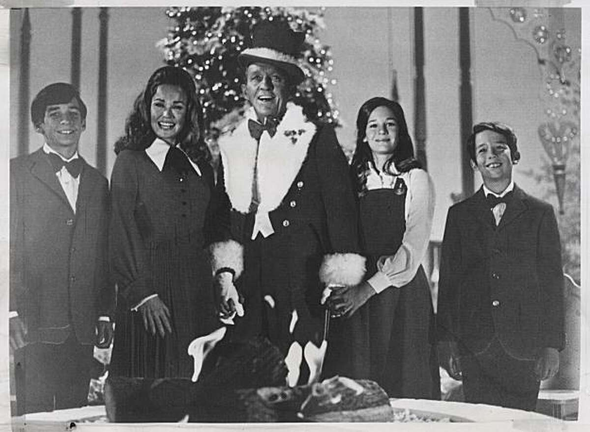 Bing Crosby and his family perform at Christmastime in 1971. From left: son Harry, wife Kathryn, Bing, daughter Mary Frances and son Nathaniel. Photo was taken in 1971.