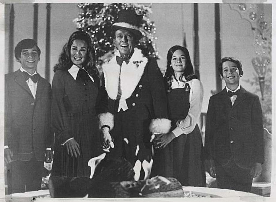 Bing Crosby and his family perform at Christmastime in 1971. From left: son Harry, wife Kathryn, Bing, daughter Mary Frances and son Nathaniel.  Photo was taken in 1971. Photo: Chronicle Archive, SF Chronicle
