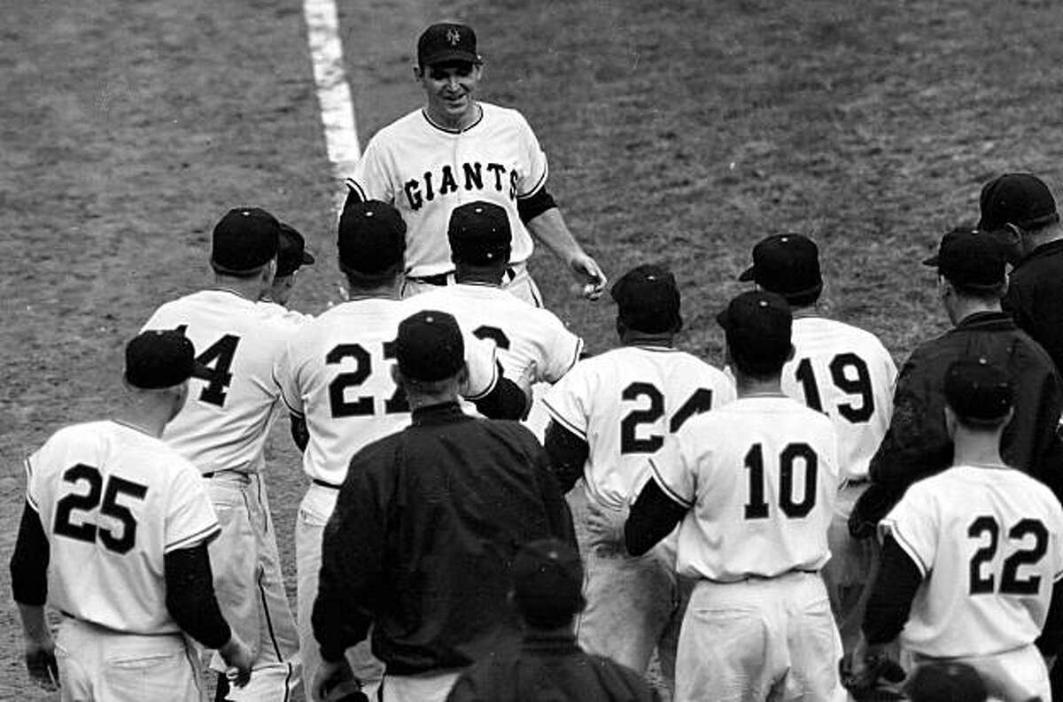 FILE - In this Sept. 29, 1954, file photo, New York Giants baseball players converge on pinch-hitter Dusty Rhodes, top center, as he comes in to score after hitting a 10th inning three-run home run to give the Giants a 5-2 win over the Cleveland Indians in Game 1 of the World Series opener at the Polo Grounds in New York. Rhodes, who helped the Giants win their last World Series title in 1954, died on Wednesday June 17, 2009, of cardiopulmonary arrest at Valley Hospital Medical Center in Las Vegas, the Clark County coroner's office said Thursday, June 18, 2009. He was 82. (AP Photo/File)