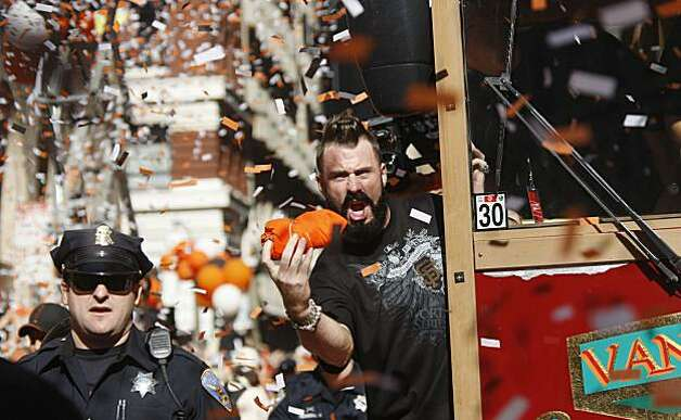 After the San Francisco Giants won the World Series, Brian Wilson throws t-shirt to fans on Montgomery street during the ticker tape victory parade on Market Street on Wednesday Nov. 03, 2010 in San Francisco, Calif. Photo: Mike Kepka, The Chronicle
