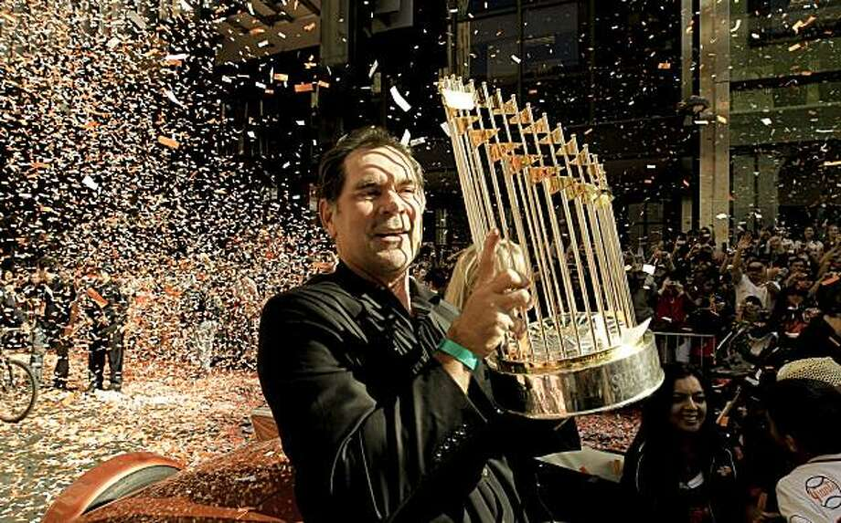 Giants' manager, Bruce Bochy displays the championship trophy for the fans to see, as the City of San Francisco celebrates the World Series Champion Giants with a parade down Market Street, on Wednesday Nov. 3, 2010 in San Francisco, Calif. Photo: Michael Macor, San Francisco Chronicle