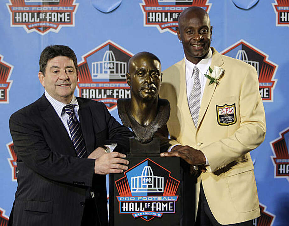 Former San Francisco 49ers great Jerry Rice, right, poses with former 49ers owner Eddie DeBartolo Jr. after Rice's enshrinement in the Pro Football Hall of Fame in Canton, Ohio Saturday, Aug. 7, 2010. Photo: Mark Duncan, AP