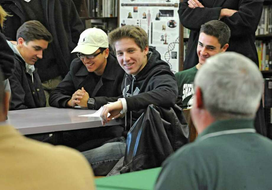 Senior members of the soccer team listen as Shenendehowa soccer coach Mike Campisi officially announces that he's stepping down from his role as head coach and talks about his new roles Monday, Jan 9, 2012 at the High School in Clifton Park, N.Y.  The seniors are, from left, Dan Cavosie, Saamy Teymouri (cq), Shane Breznak and Tom Flaim. (Lori Van Buren / Times Union) Photo: Lori Van Buren