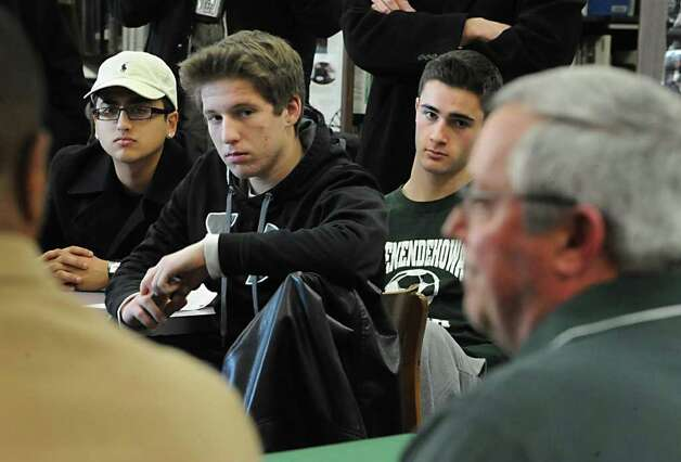 Senior members of the soccer team listen as Shenendehowa soccer coach Mike Campisi officially announces that he's stepping down from his role as head coach and talks about his new roles Monday, Jan 9, 2012 at the High School in Clifton Park, N.Y.  The seniors are, from left, Saamy Teymouri (cq), Shane Breznak and Tom Flaim. (Lori Van Buren / Times Union) Photo: Lori Van Buren