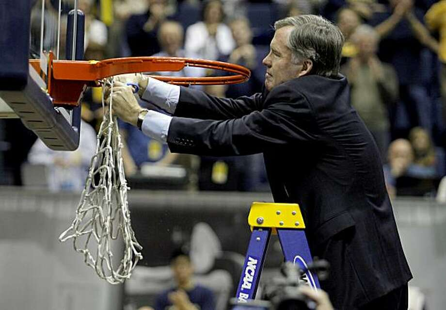 Cal coach Mike Montgomery cuts down the net after Cal's win over Arizona State at Haas Pavilion in Berkeley on Saturday. Photo: John Storey, Special To The Chronicle