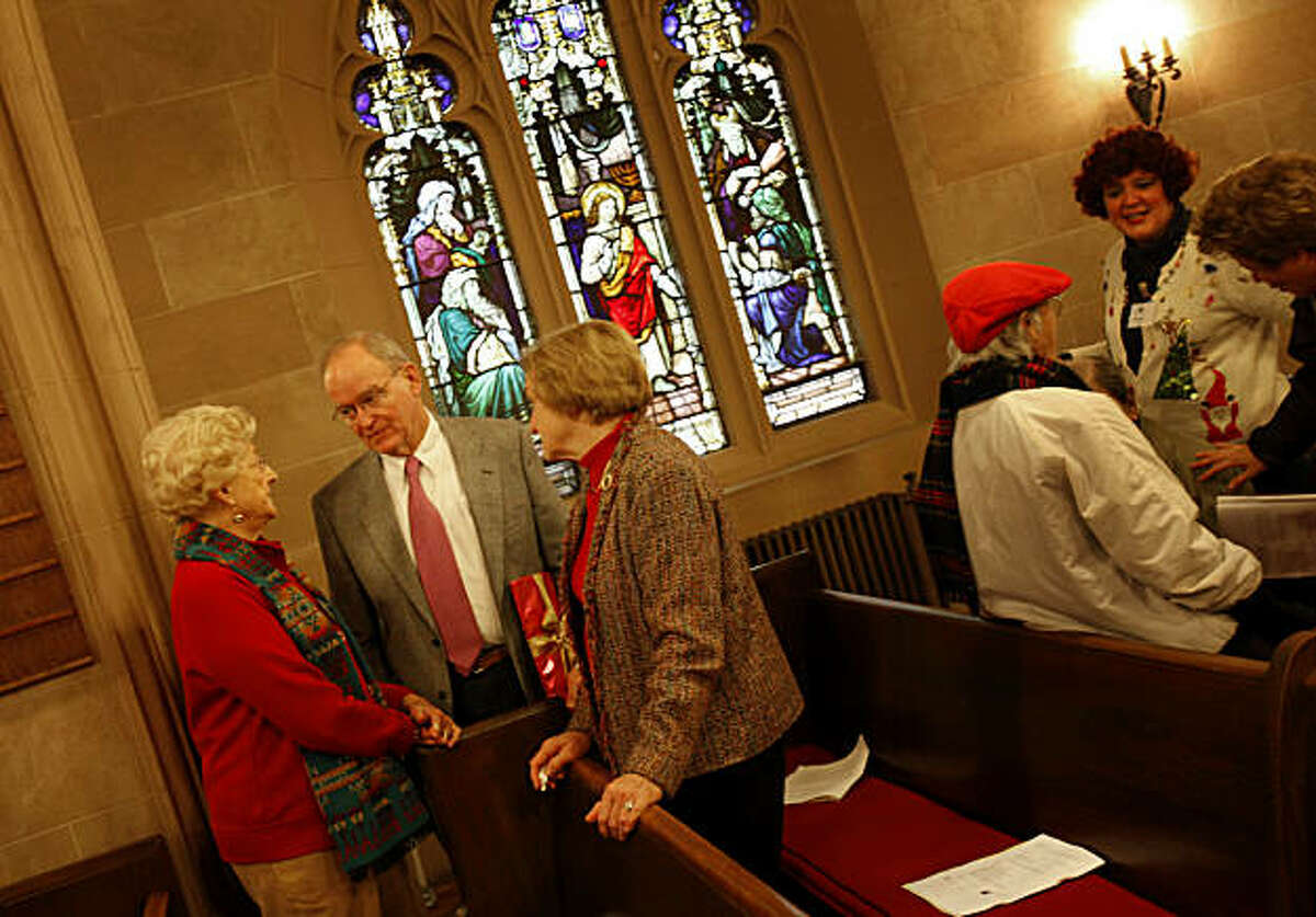 Bishop Swing (left center) and his wife Mary Swing listen to Eunice Shephard (far left) after services at St. Pauls. William Swing, the former Bishop of the Episcopal Church in California for 27 years, is enjoying his time away from the spotlight. He attends services at St. Paul's Episcopal Church in Burlingame, Calif. Sunday December 19, 2010 with his wife Mary Swing.