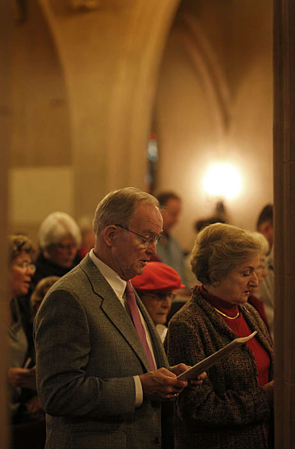Bishop Swing and his wife Mary Swing sing during Episcopal services at St. Paul's. William Swing, the former Bishop of the Episcopal Church in California for 27 years, is enjoying his time away from the spotlight. He attends services at St. Paul's Episcopal Church in Burlingame, Calif. Sunday December 19, 2010 with his wife Mary Swing.