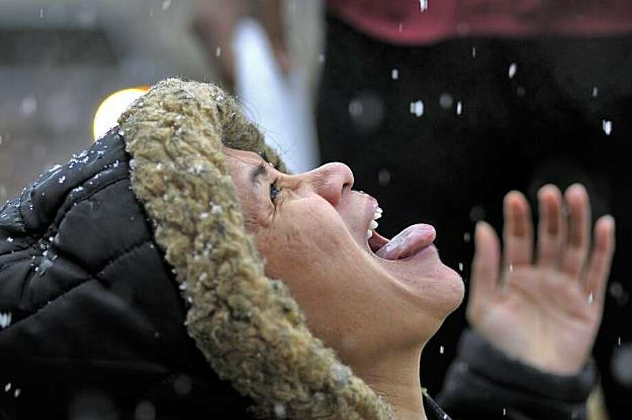 Floyd Medical Center employee Liberty Todd enjoys the morning snowfall while at work on Christmas morning Saturday, Dec. 25, 2010 in Rome Ga.  A rare white Christmas came to parts of the South as snow fell across the region. Photo: Daniel Varnado, AP