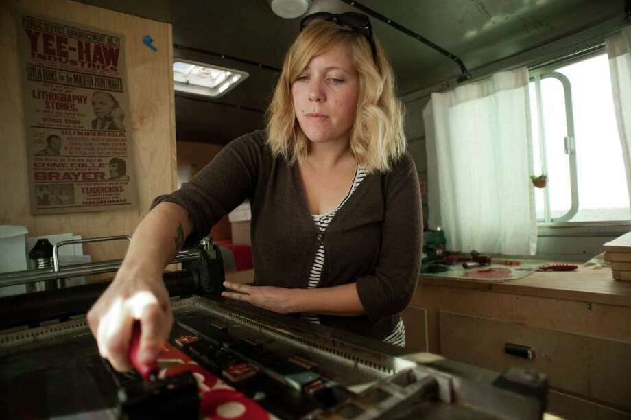 Kyle Durrie, of Portland, Ore., applies ink before making a print. She is touring the U.S. demonstrating letterpress printing. Photo: Mark Matson / Mark Matson