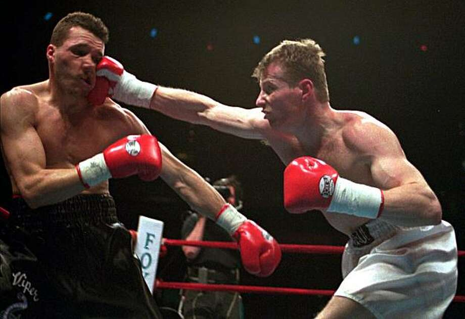 "FILE - In this April 13, 1996, file photo, junior welterweight Mickey Ward, right, of Lowell, Mass., lands a punch to the face of Lewis Veader, of Providence, R.I., during a World Boxing Union Championship bout in Boston. Thousands of movie-goers filled theaters across the country last weekend to see Mark Wahlberg's stirring portrayal of Ward in ""The Fighter."" Photo: Jim Rogash, Associated Press"
