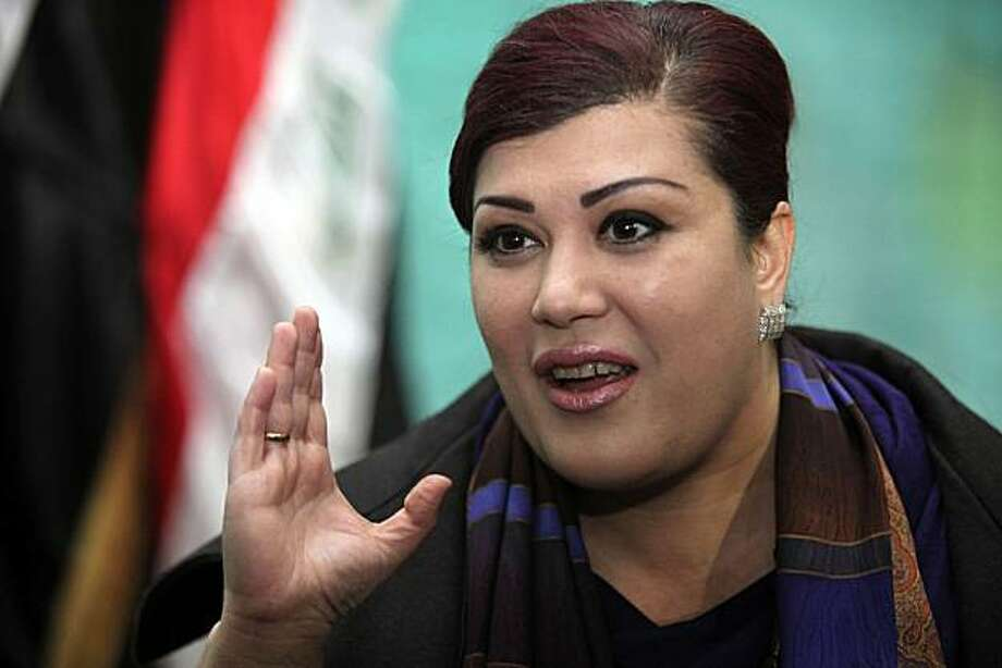 In this Feb. 7, 2010 file photo, Iraqi lawmaker Safiya al-Suhail speaks to the press in Baghdad, Iraq. Lawmaker, Safiyah al-Suhail, said Thursday Dec. 23, 2010 that a group of about 50 female legislators are appealing to the nation's top politicalleaders, the U.N. and the Arab League in hopes of getting more Cabinet posts for women. Iraqi women lawmakers are protesting the lack of female representation in the government formed earlier this week. Women make up a quarter of the 325-seat Parliament but were given only two ministries in the 44-member Cabinet that was approved after a nine-month delay. Photo: Karim Kadim, AP