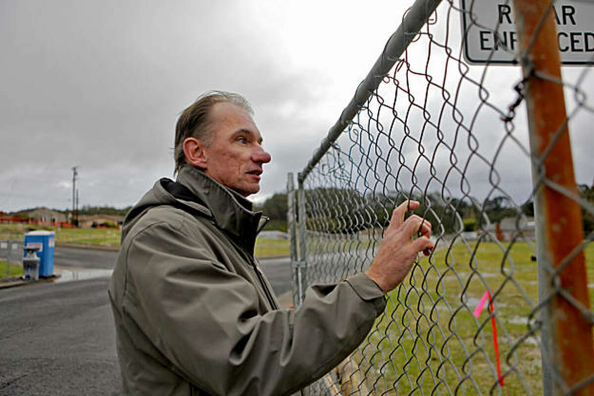 Bill Magoolaghan looks at the fenced-in site of where the gas pipe lays at the corner of Claremont Drive and Glenview Drive, Tuesday Nov. 23, 2010, in San Bruno, Calif.