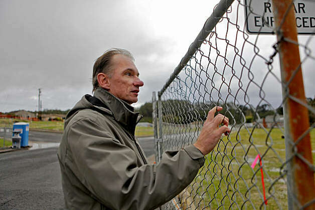 Bill Magoolaghan looks at the fenced-in site of where the gas pipe lays at the corner of Claremont Drive and Glenview Drive, Tuesday  Nov. 23, 2010, in San Bruno, Calif. Photo: Lacy Atkins, The Chronicle