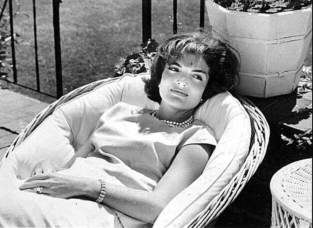FILE--This is a 1961 file handout photo from the John F. Kennedy Library & Museum showing former First Lady Jacqueline Kennedy Onassis relaxing in a patio chair at the Kennedy family home at Hyannisport, Mass., on Cape Cod in 1961. Jacqueline Kennedy Onassis, 64, died Thursday at her home in New York.(AP Photo/John F. Kennedy Library & Museum)