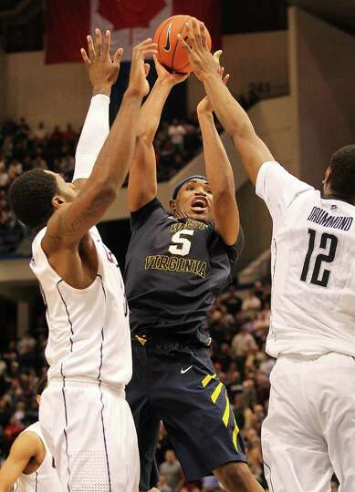 HARTFORD, CT - JANUARY 9: Kevin Jones #5 of the West Virginia Mountaineers feels the pressure from A