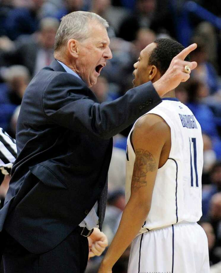 Connecticut coach Jim Calhoun, left, speaks with Ryan Boatright during the second half of Connecticut's 64-57 victory over West Virginia in an NCAA college basketball game in Hartford, Conn., on Monday, Jan. 9, 2012. (AP Photo/Fred Beckham) Photo: Fred Beckham, Associated Press / FR153656 AP