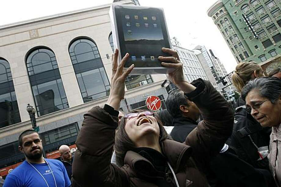 An overjoyed Sayuri Watanabe from Japan made the trip to San Francisco from Japan just to be one of the first to buy a iPads at an Apple Store in San Francisco Saturday April 3, 2010. Excited customers started forming a long line late Friday night in anticipation of the iPads first day of sales. Photo: Lance Iversen, The Chronicle