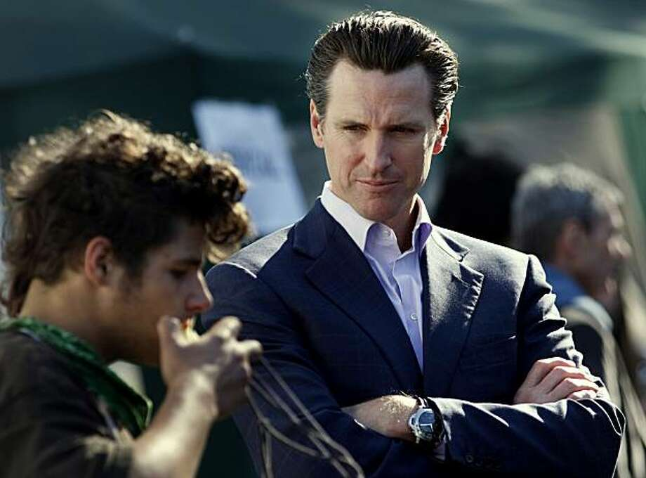 Mayor Gavin Newsom talks to a homeless youth during the  Project Homeless  Connect, Thursday, Nov. 19, 2009, in the Golden Gate Park in San Francisco, Calif. Photo: Lacy Atkins, The Chronicle