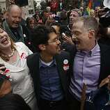 Molly McKay, Stuart Gaffney and John Lewis celebrate at the Philip Burton Federal Building after learning Chief U.S. District Court Judge Vaughn Walker ruled that Proposition 8 is unconstitutional in San Francisco, Calif., on Wednesday, Aug. 4, 2010.