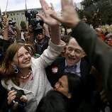 Molly McKay and John Lewis celebrate at the Phillip Burton Federal Building after learning Chief U.S. District Court Judge Vaughn Walker ruled that Proposition 8 is unconstitutional in San Francisco, Calif., on Wednesday, Aug. 4, 2010.