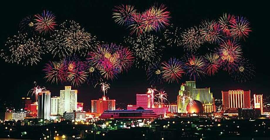 The Reno skyline explodes with fireworks on New Year's Eve. Photo: Reno-Sparks CVA