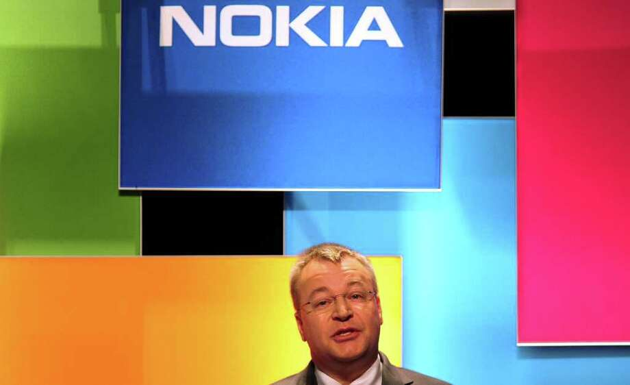 CEO Stephen Elop and Nokia Corp. are hoping for a turnaround through the use of Microsoft's new phone software. Apple and Google dominate in smartphones. Photo: FREDERIC J. BROWN / AFP