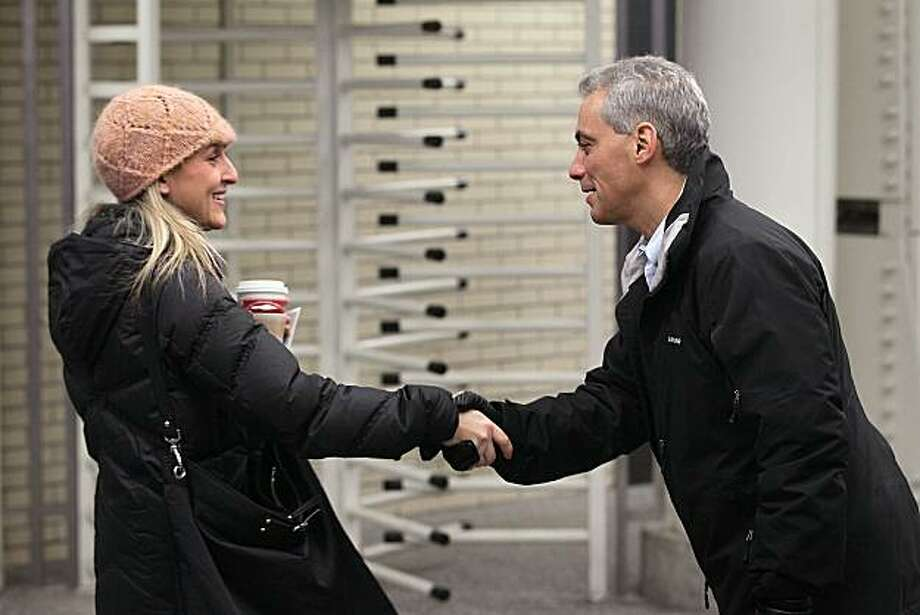"CHICAGO, IL - DECEMBER 23:  Former White House Chief of Staff and Chicago mayoral candidate Rahm Emanuel (R) greets commuters at an ""L"" stop on December 23, 2010 in Chicago, Illinois. A Chicago election board hearing officer has determined that Emanuel has met the residency requirements to run for mayor of the city. The Chicago Board of Election Commissioners meets today to consider the case.  (Photo by Scott Olson/Getty Images)  *** BESTPIX *** Photo: Scott Olson, Getty Images"
