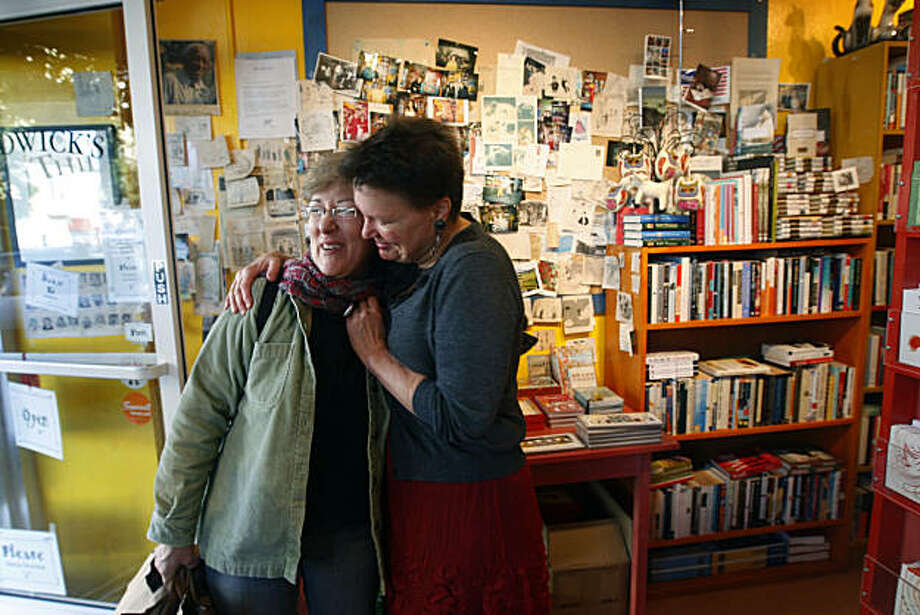 Leagrey Dimond (right) hugs longtime customer Lisa Louis at Dimond's Thidwick Books store in San Francisco, Calif., on Thursday, Dec. 23, 2010. Dimond is being forced to close her bookstore after 11 years and relocate after lawsuits were filed to force her to comply with costly ADA requirements. Photo: Paul Chinn, The Chronicle