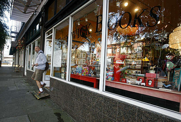 A customer leaves after shopping at Thidwick Books on Clement Street in San Francisco, Calif., on Thursday, Dec. 23, 2010. Store owner Leagrey Dimond is being forced to close her bookstore after 11 years and relocate after lawsuits were filed to force her to comply with costly ADA requirements. Photo: Paul Chinn, The Chronicle