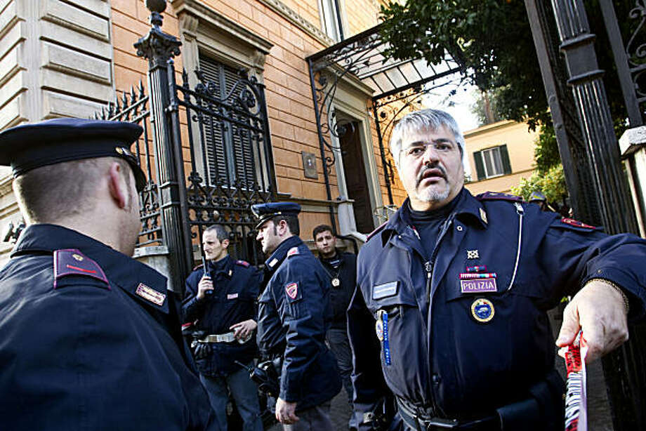 Police officers stand outside the Chilean embassy, in Rome, Thursday, Dec. 23, 2010. A pair of package bombs exploded at the Swiss and Chilean embassies in Rome on Thursday, injuring the two people who opened them, officials said. Police ordered checks atall embassies after a false alarm was also reported at the Ukrainian embassy. Photo: Angelo Carconi, AP