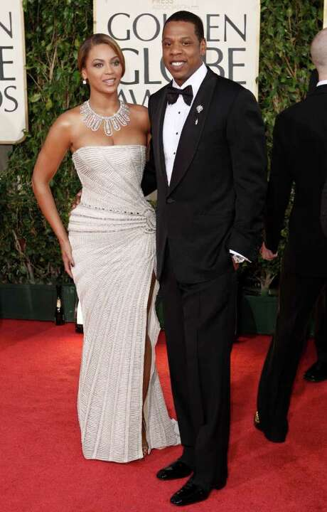 "FILE - In this Jan. 11, 2009 file photo, Beyonce, left, is joined by husband Jay-Z, as she arrives at the 66th Annual Golden Globe Awards in Beverly Hills, Calif. Through a rap verse, Jay-Z has confirmed the birth of ""the most beautiful girl in the world"" _ his newborn daughter.  The song ""Glory"" made its debut on his social website Monday, Jan. 9, 2012, two days after he and Beyonce reportedly gave birth to a daughter, Blue Ivy. (AP Photo/Matt Sayles, file) Photo: Matt Sayles / AP2009"