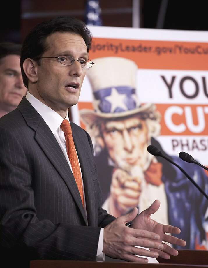 House Majority Leader Eric Cantor of Va., accompanied by Rep. Austin Scott, R-Ga., left, gestures during a news conference on Capitol Hill in Washington, Wednesday, May 11, 2011, to discuss budget cuts. Photo: Harry Hamburg, AP