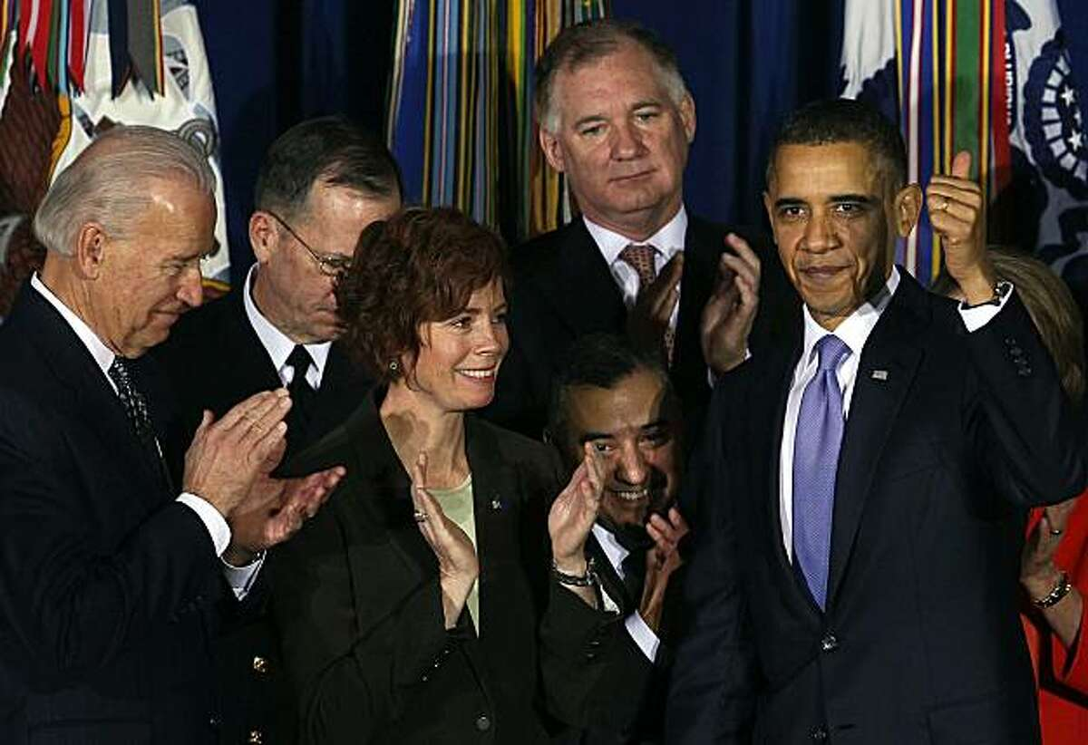 WASHINGTON, DC - DECEMBER 22: U.S. President Barack Obama (R) gives a thumbs up while Eric Alva (3rd-R), former U.S. Navy Commander Marine Staff Sgt. Zoe Dunning (3rd-L) andVice President Joseph Biden (L) look on after Obama signed legislation repealingmilitary policy law during a ceremony December 22, 2010 in Washington, DC. President Obama signed into law a bill repealing the