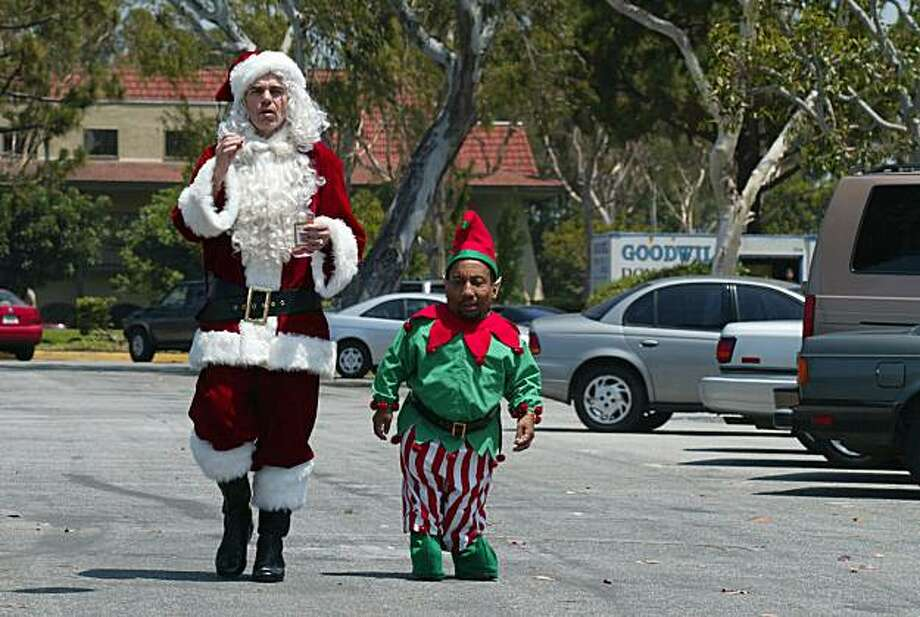 Willie T. Soke (Billy Bob Thornton)  and  Santa's Elf  (Tony Cox) are two criminals who disguise themselves as Santa Claus (Thornton) and his elf, traveling across the country to major malls, using the good will people have towards Santa to rob the stores blind. Photo: Tracy Bennett, AP