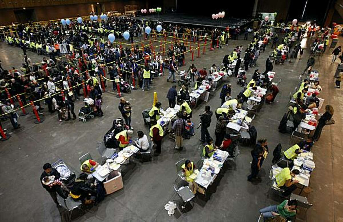 Health officials distributed 16,000 H1N1 flu vaccinations to residents at the Bill Graham Civic Auditorium in San Francisco Tuesday.