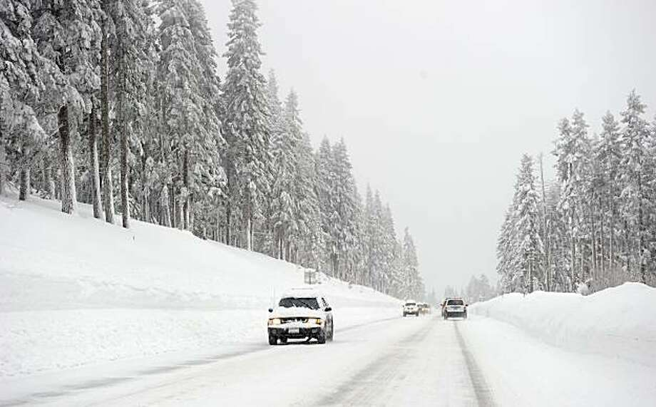 Vehicles navigate a snowy Mt. Rose Highway, which stretches between Reno and Lake Tahoe, Monday, Dec. 20, 2010. Over 10 feet of snow fell in parts of the sierra during the latest storm. Photo: Scott Sady, AP