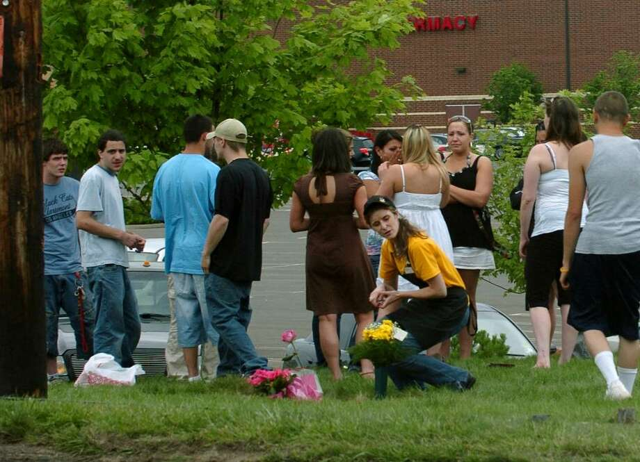 People gather to place flowers and grieve at the scene of a fatal accident which ocurred along Post Road and Dogwood Road in Orange, CT on Saturday June 13, 2009. Photo: Christian Abraham / Connecticut Post