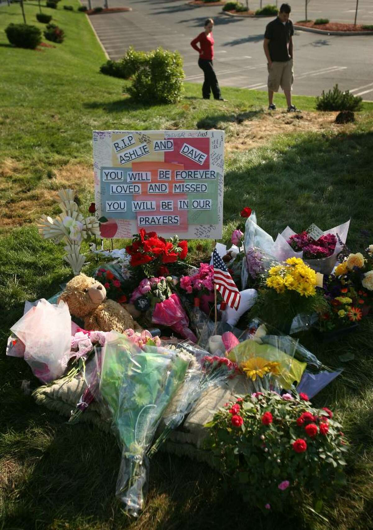 A memorial of flowers and other mementos rests along Route 1 in Orange, the site of a crash with a Milford police cruiser that took the lives of Orange teens David Servin and Ashlie Krakowski.