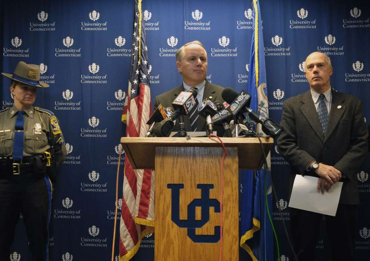 Robert S. Hudd, center, Chief of Police for the University of Connecticut Police Department, makes an announcement of an arrest in the murder of Connecticut football player Jasper Howard during a news conference on Tuesday, Oct. 27, 2009 in Storrs, Conn. Connecticut Department of Public Safety Commissioner John A. Danaher III, right, looks on. Howard, a starting cornerback on the football team, was stabbed early Oct. 18 outside a university-sanctioned dance, hours after helping his team to a homecoming game win over Louisville. Police arrested three men, John W. Lomax III of Bloomfield, Hakim Muhammad of Bloomfield, and Jamal Todd of Hartford in connection with the death of UConn football player Jasper Howard. (AP Photo/Jessica Hill)
