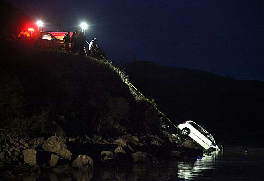 A multi-agency team pulls the vehicle containing Phylliss Bin, of Agoura Hills, up a steep embankment from the Russian River, at Jenner, Calif., on Monday evening, Dec. 20, 2010.  Bin had been missing since having dinner with a couple at the River's End Restaurant and Inn on Saturday night. Photo: Christopher Chung, AP