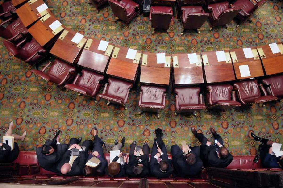 Staff members of Senators wait for Senators to come onto the floor of New York State Senate chambers to begin the session on Monday, Jan. 9, 2012 at the capitol in Albany, NY. The Senate began the 2012 session on Monday. (Paul Buckowski / Times Union)
