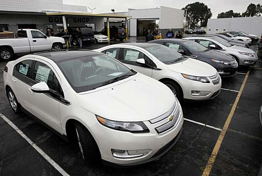 A row of 2011 Chevrolet Volt vehicles are shown Friday Dec. 17, 2010 at a Chevrolet dealership in Los Angeles. These cars are the first of the electric cars to be shipped to California. Photo: Nick Ut, AP