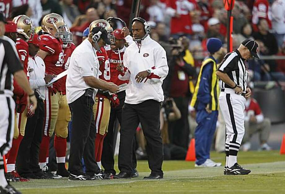 49ers quarterbacks coach Mike Johnson (center) is seen during the San Francisco 49ers and New Orleans Saints NFL football game at Candlestick Park in San Francisco, Calif., on Monday, Sept. 20, 2010.49ers quarterbacks coach Mike Johnson (center) is seen during the San Francisco 49ers and New Orleans Saints NFL football game at Candlestick Park in San Francisco, Calif., on Monday, Sept. 20, 2010.  Ran on: 10-01-2010 Mike Johnson has had a lot of stops in his pro football career, both as a player and coach.  Ran on: 12-21-2010 Niners offensive coordinator Mike Johnson lit up the Rams' defense last time. What will he do for an encore? Ran on: 12-21-2010 Niners offensive coordinator Mike Johnson lit up the Rams' defense last time. What will he do for an encore? Photo: Paul Chinn, The Chronicle