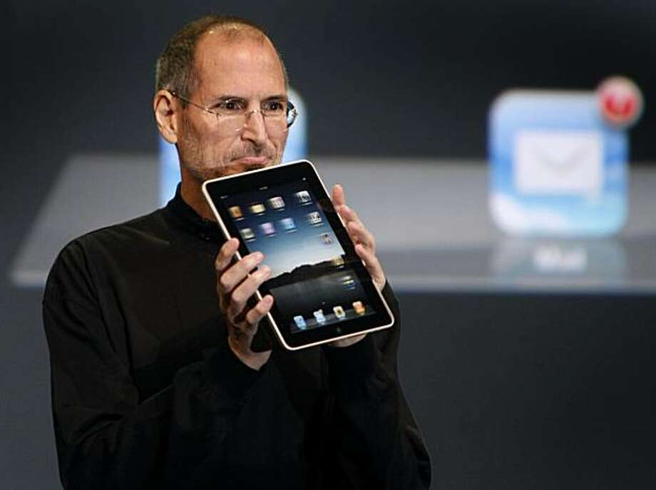 Apple CEO Steve Jobs hold up an iPad tablet after introducing the device to invited guests at the Yerba Buena Center for the Arts in San Francisco, Calif., on Wednesday, Jan. 27, 2010. Photo: Paul Chinn, The Chronicle